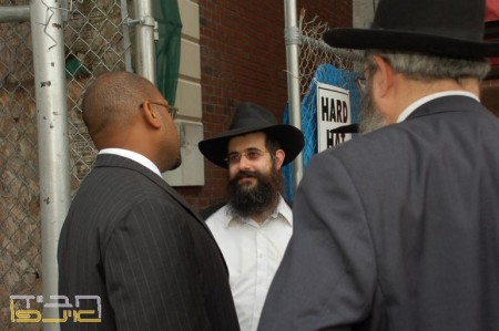 August 2008: Menachem Mendel Hendel, director of Eshel greeted the NY State Senate John Sampson along with Mordechai Chein, Chanina Sperlin and Laibish Nash, members of the Crown Heights Heights Jewish Community Council, Inc,