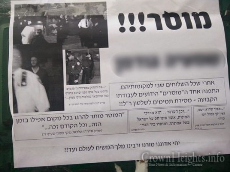"Signs calling for the ""killing of the informer"" that were hung up all around Crown Heights."
